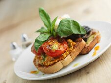 Bruschetta with tomatoes, mushrooms and poached egg