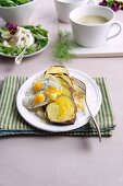 Sweet potatoes with fried quail's eggs
