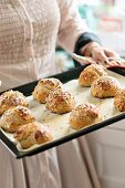 Freshly baked breakfast rolls on a baking tray