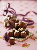 Marzipan pralines with chocolate glaze and flaked almonds