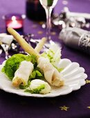 Halibut rolls on a bed of lettuce with cream cheese