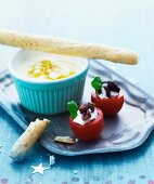 Tomatoes filled with cream cheese and olives, and lemon cream with grissini