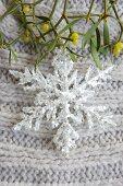 Glittery snowflake and sprig of mistletoe (Christmas arrangement)