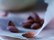 Almonds on a piece of greaseproof paper
