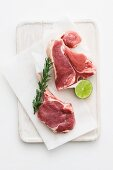Fresh veal chops, rosemary and limes