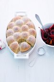 Rohrnudeln (baked, sweet yeast dumplings) with red wine pears