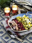 Herring salad with gherkins, eggs and beetroot for Christmas