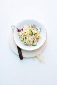Truffle tagliatelle with courgettes and red onions