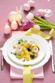 Steamed zander rolls with potatoes, olives and pine nuts for Easter