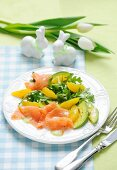 Salmon and avocado salad with oranges and rocket for Easter