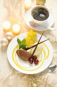 A duo of chocolate mousse with fruit for Christmas