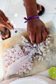 Ceviche being made: fish being diced