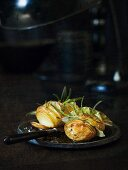Hasselback potatoes with bay leaves and rosemary