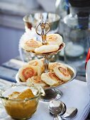 Salmon and puff pastry roulade on a cake stand served with mustard sauce (Christmas)
