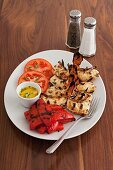 Grilled scampi with roasted peppers