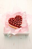 A heart-shaped raspberry tart with vanilla-quark cream