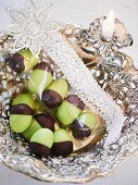 Green marzipan acorns with chocolate cups wrapped as small present
