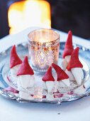 Festive arrangement of marzipan gnomes
