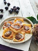 Flaky pastries with plums