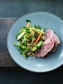 Roast lamb with a grain a vegetable mix