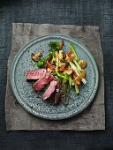 Strip steak with ramen noodles and vegetables