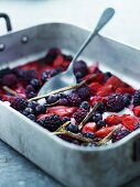 Summer berries with liquorice, lemon and cane sugar in a baking tin
