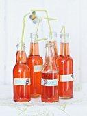 Bottles of homemade strawberry and rosewater lemonade
