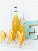 Bottles of homemade orange and ginger lemonade