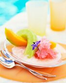 Cold melon dessert with edible flowers