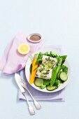 Steamed cod with spring vegetables