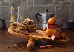 Bread, meat, eggs and sausage on a chopping board