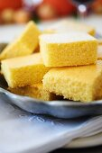 Pieces of cornbread on a table laid for Thanksgiving dinner