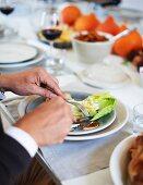 A man eating Waldorf salad at Thanksgiving