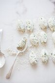 Stinging nettle Gnudi (ricotta dumplings) being made