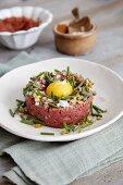 Beef tartar with egg yolk