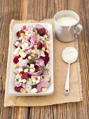 Herring salad with beetroot, onion, apple and mayonaise