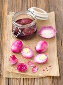 Eggs preserved in beetroot juice and vinegar