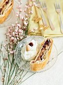 Apple strudel with cranberries and whipped cream
