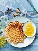 Sponge cake waffles with mango fillets