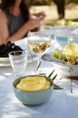 Aioli and a couscous salad on on a laid table