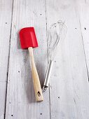 A spatula and a whisk