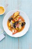 Bouillabaisse on a white plate