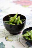 Cooked soya beans in black bowls (Japan)