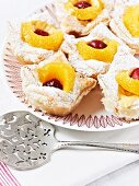 Vanilla pastries with fruit and icing sugar