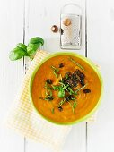 Pumpkin soup with caramelised pumpkin seeds and basil