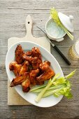 Chicken wings with celery and a dip