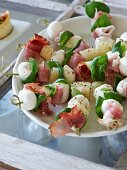 Ham and mozzarella skewers with basil
