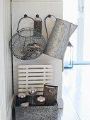 Wire baskets, zinc jug, bottles and old kitchen utensils