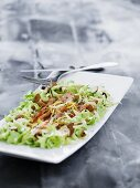 Marinated lemon salmon with white cabbage and almonds