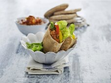 Pita breads stuffed with mince sauce, peppers and lettuce